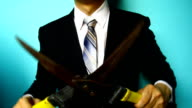 businessman hand with Grass Scissors