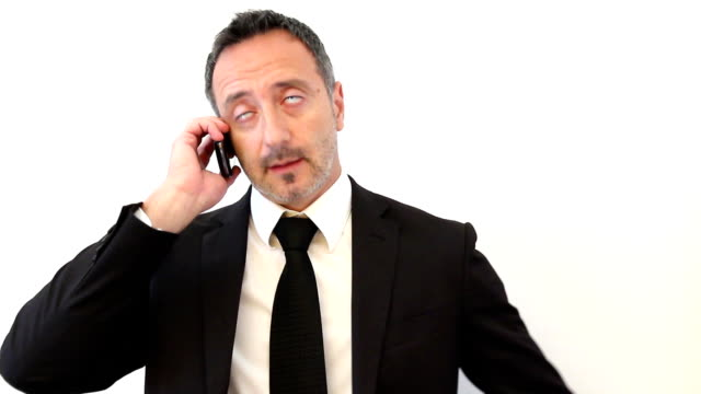 Businessman has stress and screams in telephone
