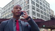 Businessman having a conversation with mobile phone in downtown Chicago