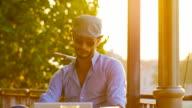 Businessman hipster in cafe on laptop