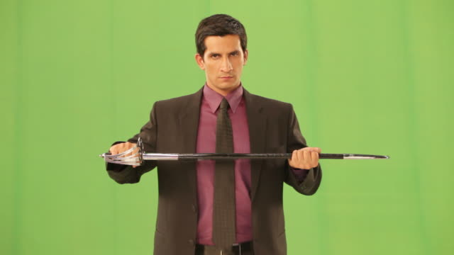 Businessman holding a sword
