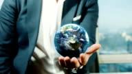 Businessman Holding Globe