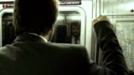 HD: Businessman Holding On To The Subway Pole