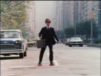 1978 businessman in suit carrying briefcase roller skating on NYC street / educational