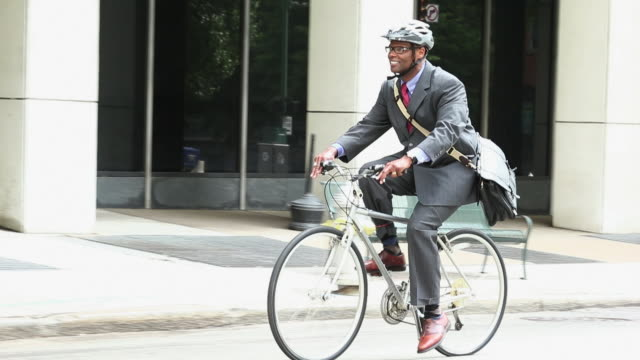 WS TS Businessman in Suit Riding Bicycle to Work in City / Richmond, Virginia, USA
