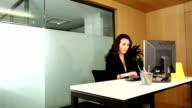 Businessman interrupts working businesswoman for her signature