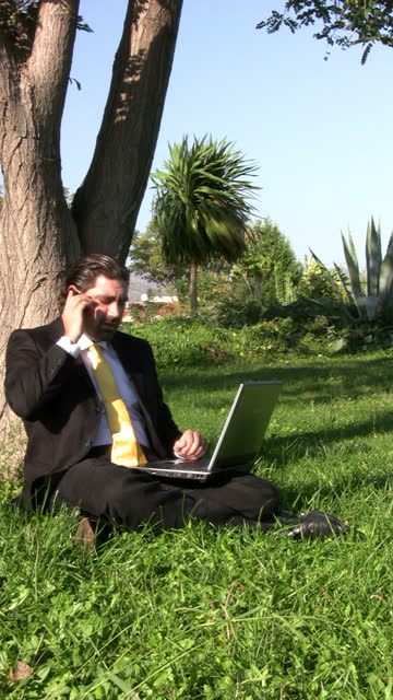 Businessman is working outdoors