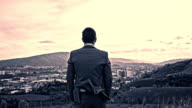 Businessman looking across the city