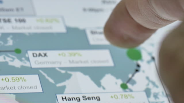 Businessman looking at Stock Market around the world,Close-up