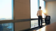 Businessman looking out of the window in office