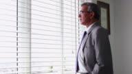 Businessman looking outside from window