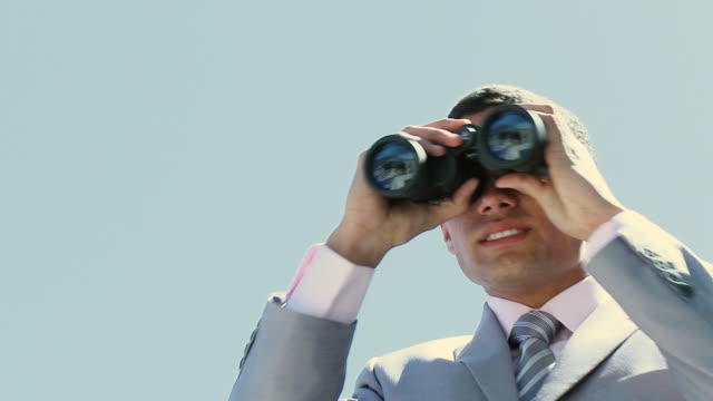 CU LA Businessman (16-17) looking through binoculars / Cape Town, South Africa