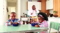 Businessman making breakfast for his children