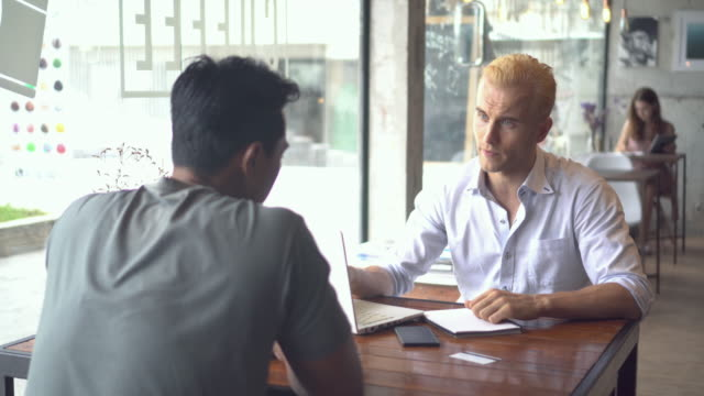 Businessman meeting in coffee shop.