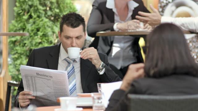 HD: Businessman On A Coffee Break