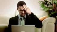 HD: Businessman On A Laptop Having Headache