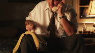 businessman on the phone ordering takeout food and smoking a cigarette