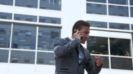 Businessman on the phone showing a fist pump