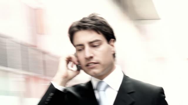 HD STEADYCAM: Businessman On The Phone