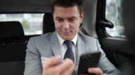 Businessman paying via app for taxi cab ride