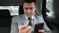 Businessman paying via app for taxi cab ride