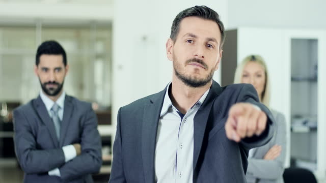 Businessman pointing on you
