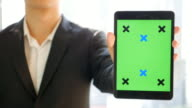Businessman present Digitial Tablet Green screen