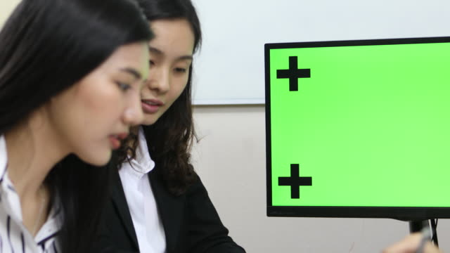 Businessman Presenting Something at Meeting with computer green screen