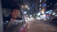 MS TS businessman riding in a taxi at night, Hong Kong