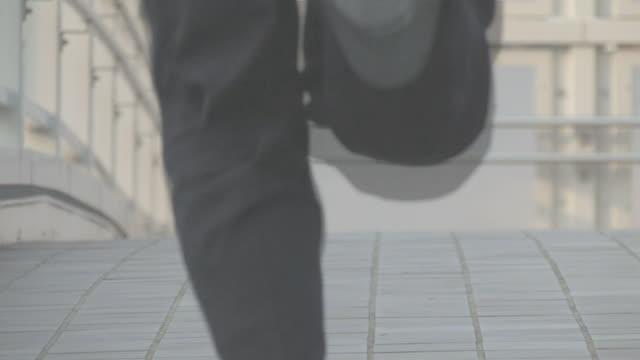 Businessman rushing along
