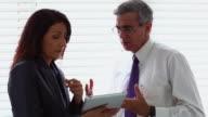 Businessman scolding a businesswoman in an office