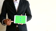Businessman show chroma key tablet for presentation on a white background,Green screen, 4K(UHD)