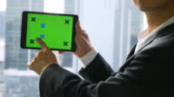 Businessman Show Digital tablet with green screen