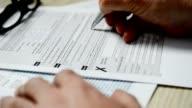 Businessman signs tax form 1040