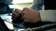 Businessman smashing laptop with fist