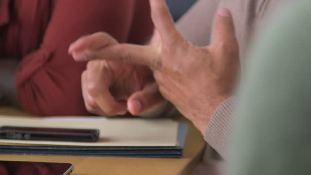 businessman speaking with his hands