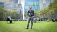 Businessman standing in Bryant Park, New York City, New York, USA