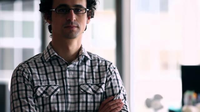 MS TU R/F Businessman standing in high tech office smiling/Washington, USA