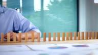 businessman stop domino slow motion