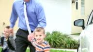 Businessman taking boys to school