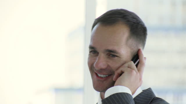 CU Businessman talking on cell phone / Cape Town, South Africa