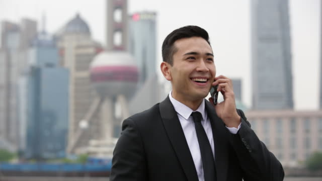 http://media.gettyimages.com/videos/businessman-talking-on-phone-in-shanghai-china-video-id475236252?s=640x640