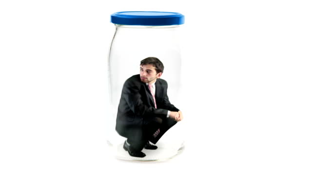 businessman trapped in jar