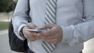 4K: Businessman Typing On His Smart Phone.
