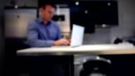 Businessman typing on laptop keyboard