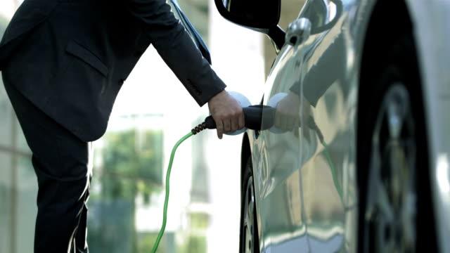 HD: Businessman Unplugging His Car