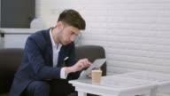 Businessman Using Digital Tablet At The Café
