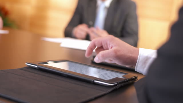 HD: Businessman Using Digital Tablet During Meeting