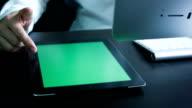 Businessman using digital tablet touchscreen ,Chroma key.