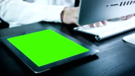 Businessman using digital tablet touchscreen ,Chroma key.